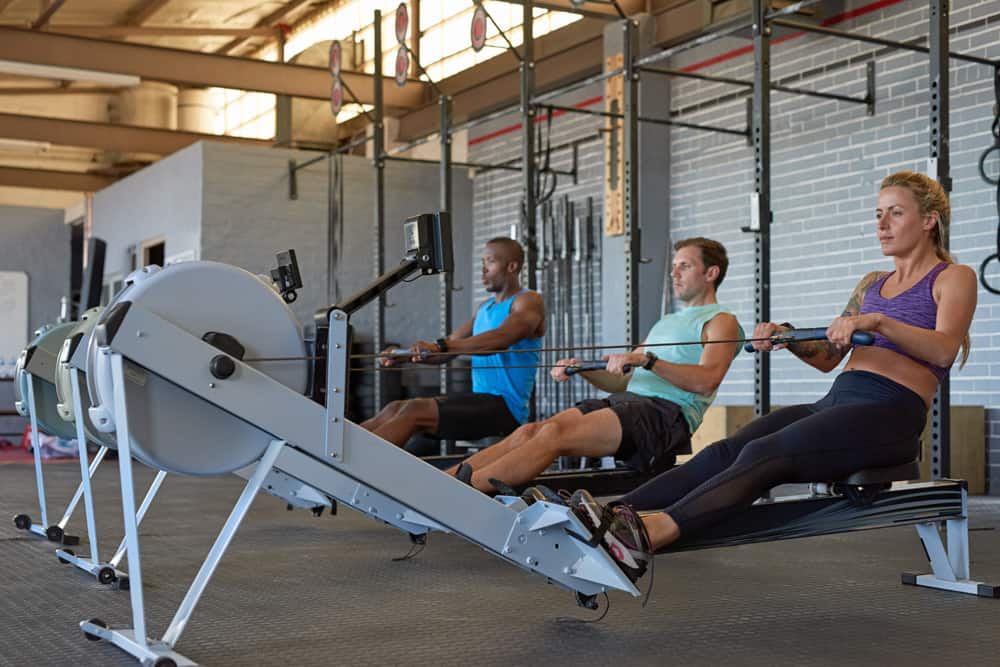 People doing a rowing machine workout