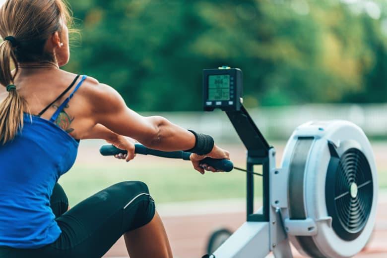 Athlete training on rowing machine