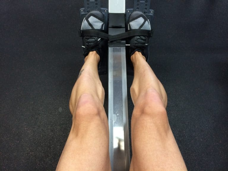 Feet strapped into a owing machine