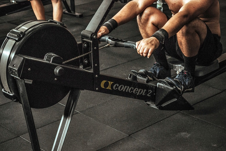 crossfit athlete using concept2 rowing machine