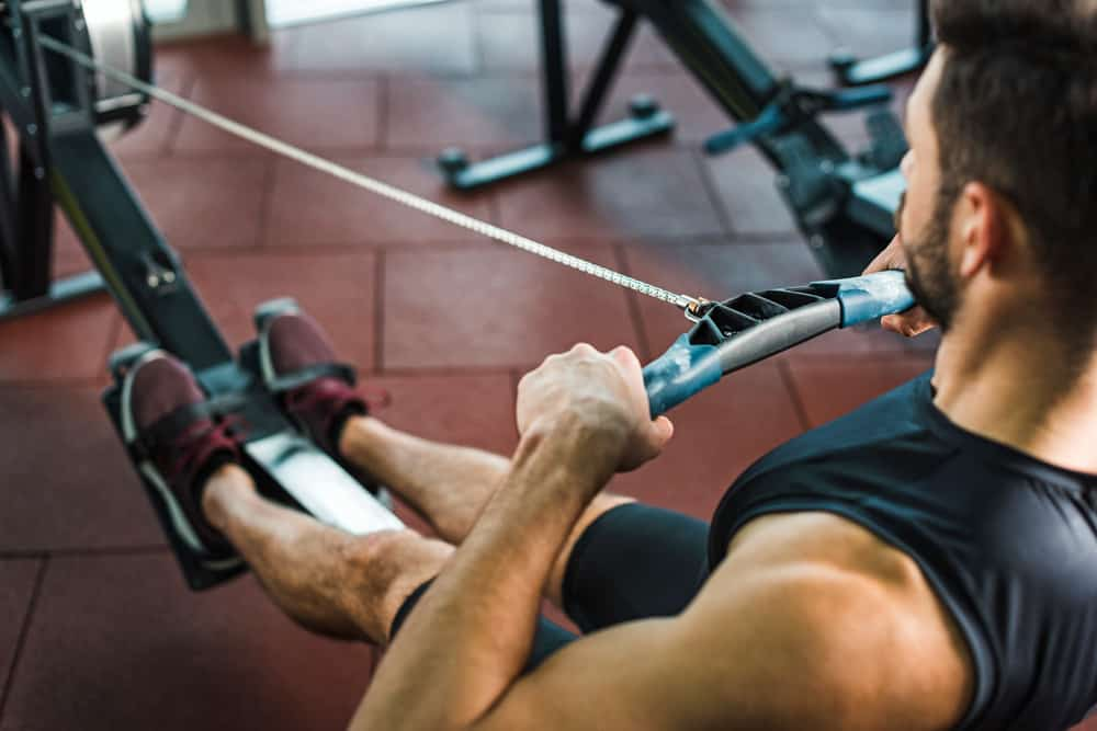 man with good rowing machine technique